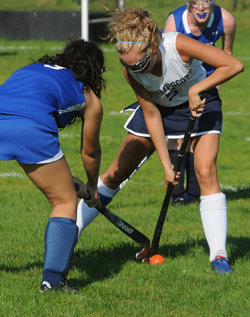 Swampscott:<br /> Swampscott Julie Anne Marquis, right, fights with Danvers' Courtney Torchia for possession of the ball during the Danvers at Swampscott field hockey game.<br /> Photo by Ken Yuszkus/The Salem News, Wednesday, September 12, 2012.