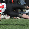 Beverly:<br /> Salem's Joey Dinh stretches out to gain yardage after Beverly's Nick Theriault tackles him at the Salem at Beverly football game at Hurd Stadium.<br /> Photo by Ken Yuszkus/Salem News, Thursday, November 25, 2010.