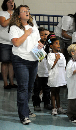 Salem:<br /> Principal Jean-Marie Kahn leads the Pledge of Allegiance at the beginning of the Carlton school-wide opening ceremony to celebrate the start of school.<br /> Photo by Ken Yuszkus/The Salem News, Thursday, September 6, 2012.
