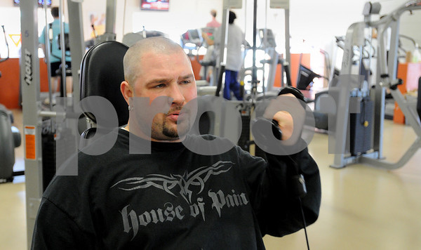 Salem:<br /> Bryan Brown works out on the hoist bicept curl machine in the weight room at the YMCA.<br /> Photo by Ken Yuszkus/Salem News, Wednesday December 3, 2008.