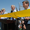 Ipswich:<br /> State senator Bruce Tarr cuts the ribbon at the ribbon cutting ceremony in front of the new wind turbine Tuesday afternoon.<br /> Photo by Ken Yuszkus/Salem News, Tuesday, June 7, 2011.