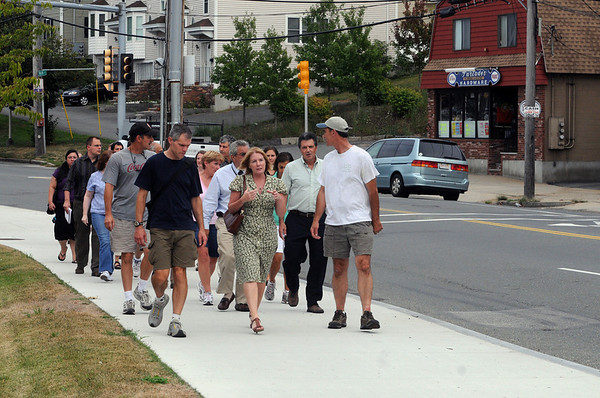 """Peabody:<br /> Walking along Main Street in Peabody on Tuesday evening are planners who are looking for ways to improve the """"corridor"""" from Peabody to Salem.<br /> Photo by Ken Yuszkus/Salem News, Tuesday August 17, 2010."""