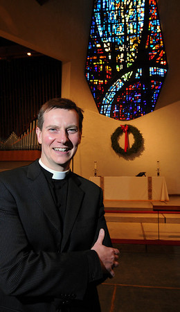 Hamilton:<br /> Patrick Gray, the new pastor of Christ Church, stands in the church.<br /> Photo by Ken Yuszkus/Salem News, Tuesday, January 12, 2010.