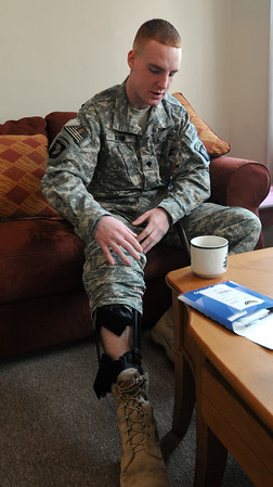 Salem:<br /> Army Specialist Steven Bohn, is just back home from Walter Reed Hospital after suffering wounds in Afghanistan. He wears a leg brace after his spinal surgery.<br /> Photo by Ken Yuszkus/Salem News, Tuesday, April 7, 2009.