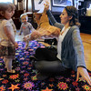 Peabody:<br /> Jackie Bowden, right, of the Boston Ballet School, shows, from left, Gracie Morrison, Quinn Makary, and Lily Freitas, a ballet costume. Costumes and pointe shoes were shown and books were read during the Ballet story hour presentation at the Peabody Institute Library on Thursday morning.<br /> Photo by Ken Yuszkus/Salem News, Thursday, April 19, 2012.