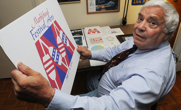 Marblehead:<br /> Lou Regilio spent 25 years entering logos in the design contest for Marblehead Arts Festival logos before finally winning this year. He is holding this year's logo that he designed.<br /> Photo by Ken Yuszkus/Salem News, Friday, June 17, 2011.