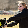 Danvers:<br /> Logan Carabello warms up during the Danvers High softball practice at Great Oak School field.<br /> Photo by Ken Yuszkus/Salem News, Monday, March 28, 2011.