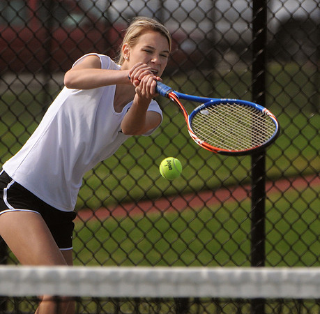 Peabody:<br /> Bishop Fenwick's Meghan McCarthy returns the ball during her singles match at the North Reading at Bishop Fenwick girls state tennis tournament playoff match.<br /> Photo by Ken Yuszkus/Salem News, Friday, June1, 2012.