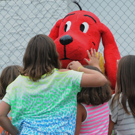 Peabody:<br /> Clifford the Big Dog is greeted by children in the Leather City Common at the Peabody International Festival.<br /> Photo by Ken Yuszkus/The Salem News, Sunday, September 9, 2012.