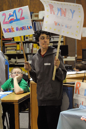 Peabody:<br /> Ali Khan, 7th grade student at Higgins Middle School, holds up signs at the polling area during the school's primary on Monday.<br /> Photo by Ken Yuszkus/Salem News, Monday,  March 5, 2012.