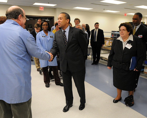 Peabody:<br /> Governor Patrick meets employees while touring Analogic Corporation. He was at Analogic Corporation to make an announcement relative to job training. To his right is Joanne Goldstein, Secretary of Labor and Workforce Development, who also toured the facility and spoke.<br /> Photo by Ken Yuszkus/Salem News, Tuesday, April 27, 2010.
