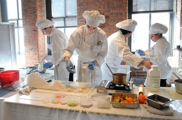 Boston:<br /> From left, Michael Almeida, Doug Toth, James Candido, and Katherine Pittsley, Peabody culinary students, prepare their dishes while they compete during the state Prostart competition in Boston. <br /> Photo by Ken Yuszkus/Salem News, Friday, February 11, 2011.