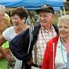 Beverly:<br /> From left, John Dario of Beverly, Marge Cleary of Peabody, Stan Holiday and his wife Jean Holiday of Beverly, laugh and smile while waiting in line to enter the large tent to collect free gifts from the various vendors during the Senior Citizens Day at Lynch Park in Beverly<br /> Photo by Ken Yuszkus/Salem News, Thursday August 5, 2010.