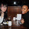 Marblehead:<br /> Yulin Wu of Malden, left, and Lataya Ferguson of East Boston, both artists that submitted logo designs, attend the Marblehead Festival of Arts  Logo Premiere Party held at The Landing Restaurant on Tuesday January 25.<br /> Photo by Ken Yuszkus/Salem News, Tuesday, January 25, 2011.