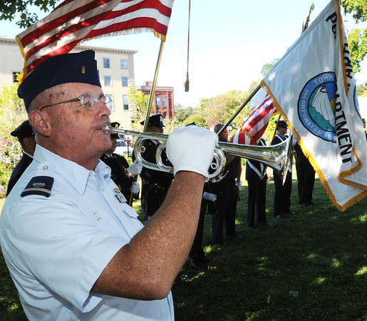 Marblehead:<br /> John Collins of the Coast Guard Auxiliary plays taps during the remembrance ceremony to commemorate the 11-year anniversary of the September 11th terrorist attacks. The ceremony was held at Memorial Park.<br /> Photo by Ken Yuszkus/The Salem News, Tuesday, September 11, 2012.