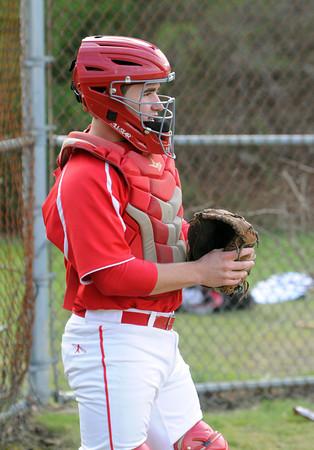 Salem;<br /> Catcher/captain Teaghan Malionek at the Salem High baseball scrimmage with North Reading.<br /> Photo by Ken Yuszkus/Salem News, Thursday, April 5, 2012.