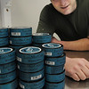 Danvers:<br /> Jake Sweeney, of Jake's Mint Chew, is near some containers of wintergreen flavored Jake's Mint Chew. There are six different flavors of Jake's Mint Chew.<br /> Photo by Ken Yuszkus/Salem News, Friday,  March 23, 2012.