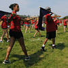 Salem:<br /> Merllyn Sanchez, left, performs during the Salem High School marching band demonstration for the public Friday morning. They were finishing up a week of band camp.<br /> Photo by Ken Yuszkus/The Salem News, Friday, August 24, 2012.