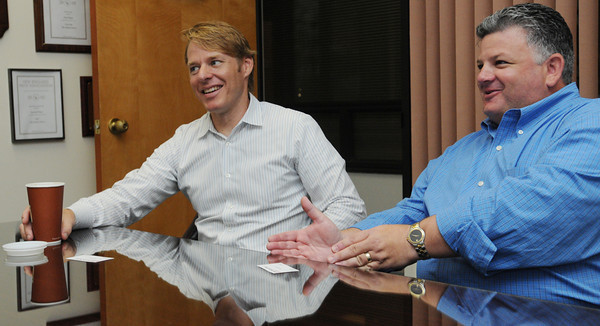 Beverly:<br /> Peter Furniss, left, and Scott Silverstein, the two principals of Footprint Power, speak to The Salem News.<br /> Photo by Ken Yuszkus/The Salem News, Wednesday, August 15, 2012.