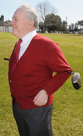 Beverly:<br /> Mayor Bill Scanlon stretches with his golf club after  hitting a golf ball from the first tee to mark the opening of the Beverly Golf and Tennis Club under its new operator, Golf Facilities Management Inc..<br /> Photo by Ken Yuszkus/Salem News, Thursday, March 25, 2010.