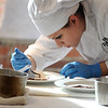 Boston:<br /> Peabody culinary student Katherine Pittsley works on the details of her presentation while preparing her food during the state Prostart competition in Boston. <br /> Photo by Ken Yuszkus/Salem News, Friday, February 11, 2011.