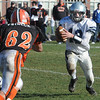 Ipswich:<br /> Hamilton-Wenham's Trevor Lyons runs the ball as Ipswich's Peyton Primack closes in during the Hamilton-Wenham at Ipswich football game on Thanksgiving Day.<br /> Photo by Ken Yuszkus/Salem News, Thursday, November 24, 2011.