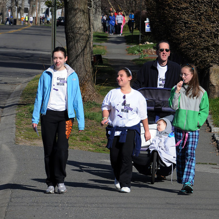 Beverly:<br /> Danielle Tetrault, Caroline Joseph, Paul Tetrault pushes son T. J. Tetrault in a stroller, and Nicki Tetrault walk along Corning Street in Beverly as part of the 33rd annual Good Friday Walk, which raises money to help needy families on the North Shore.<br /> Photo by Ken Yuszkus/Salem News, Friday, April 6, 2012.