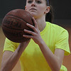 Danvers:<br /> Kim Schuyler, a junior at Essex Aggie, shoots the ball toward the net at tryouts for girls basketball.<br /> Photo by Ken Yuszkus/Salem News, Friday, December 3, 2010.
