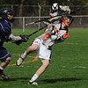 Beverly:<br /> Marblehead's Cody Cohan, left, shoves Beverly's Tyler Martz , who has the ball, during the Hamilton-Wenham at Beverly boys lacrosse game at Hurd Stadium.<br /> Photo by Ken Yuszkus/Salem News, Thursday, May 5, 2011.