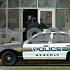 Beverly:<br /> Police enter Beverly High School during the lockdown of the school. There were 22 caliber long rifle bullets found in the school that prompted the decision to lockdown the school.<br /> Photo by Ken Yuszkus/Salem News, Wednesday, October 29, 2008.