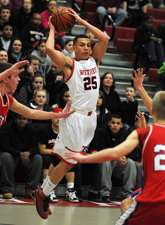 Salem:<br /> Salem's Rafael Medranoflies in the air as he throws  the ball during the Burlington at Salem boys basketball game in first round of Division 2 North state playoffs.<br /> Photo by Ken Yuszkus/Salem News, Tuesday, March 1, 2011.
