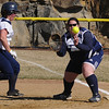 Beverly:<br /> Endicott College's Krista Fales gets back to first base safely as Gordon's Emily Borden gets the throw for a pick off try during the Gordon at Endicott College softball game.<br /> Photo by Ken Yuszkus/Salem News, Tuesday, March 29, 2011.