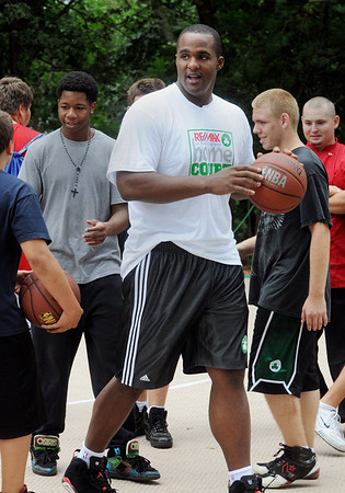 """Salem:<br /> Celtics Glen """"Big Baby"""" Davis, shoots some basketball with some of the boys at the Plummer Home for Boys. Celtics Glen """"Big Baby"""" Davis and former Celtics, Cedric Maxwell, were there for the dedication of the basketball court that the Celtics helped build along with the NFL quarterback Steve Young's Foundation. They also shot a few hoops with the kids.<br /> Photo by Ken Yuszkus/Salem News, Monday August 16, 2010."""