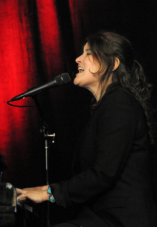 Danvers:<br /> Paula Cole sings and plays the piano at the Wellspring House's 12th Annual Women Honoring Women Luncheon at Crowne Plaza.<br /> Photo by Ken Yuszkus/Salem News, Monday, May 3, 2010.