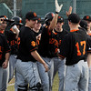 Beverly:<br /> Beverly's Anthony DiOrio comes home to congratulating teammates after hitting a homerun at the beginning of the Newburyport at Beverly baseball game at Cooney Field.<br /> Photo by Ken Yuszkus/Salem News, Monday, April 11, 2011.