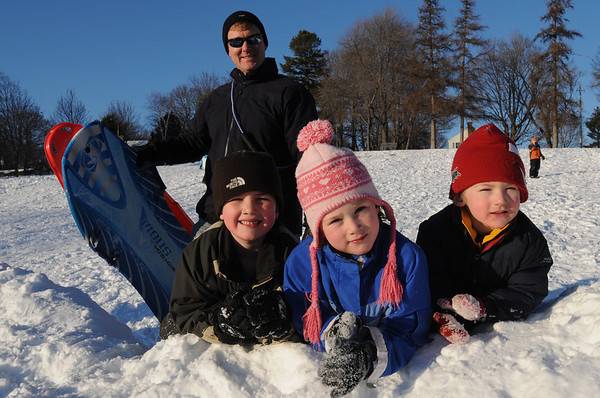Beverly:<br /> From left in front is Matthew Dickman, Ava Dickman, James Dickman, and in back is Jed Dickman, father of Ava and James, and uncle to Matthew. They are all from Beverly. They were sledding at Lynch Park.<br /> Photo by Ken Yuszkus/Salem News, Tuesday, December 22, 2009.