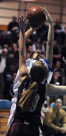 Danvers:<br /> Danvers' Sarah Palazola tries to shoot during the Gloucester High School at Danvers High School girls basketball game.<br /> Photo by Ken Yuszkus/Salem News, Tuesday, January 4, 2011.