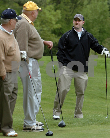 Peabody:<br /> Matt Jenkins, right, speaks with, John Strauss, left, and Jim Toabe, center, both from Peabody, on the 12th tee during the Peabody Golf Day at Salem Country Club.<br /> Photo by Ken Yuszkus/Salem News, Monday May 18, 2009.