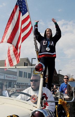 Danvers:<br /> Meghan Duggan, 2010 U.S. women's hockey silver medalist from Danvers, waves to the crowds in Danvers Square during the parade in her honor.<br /> Photo by Ken Yuszkus/Salem News, Sunday, March 21, 2010.