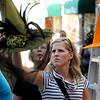 Salem:<br /> Ariane Thibault, of Quebec, looks over a witch hat for sale at the tent of one of the vendors on Essex Street on Sunday during the Salem Haunted Happenings.<br /> Photo by Ken Yuszkus/Salem News, Monday, October 10, 2011.