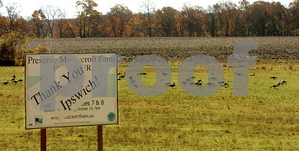 Ipswich:<br /> A sign on Argilla Road thanks the town's efforts to preserve open space on the Maolecroft Farm. Canada geese graze on part of the open space at the farm.<br /> Photo by Ken Yuszkus/Salem News, Sunday October 25, 2009.