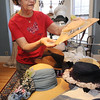 Peabody:<br /> Ann Birkner holds a hat from the 1930s and the bottom left, is a hat from the 1923. which are part of the Hats Off to History and Art exhibit.<br /> Photo by Ken Yuszkus/Salem News, Thursday, July 7, 2011.