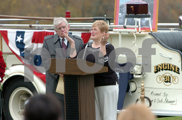 Danvers:<br /> Jewel Barnett, widow of Donald Barnett, Jr., shares her memories near the end to the memorial service for her husband, Donald Barnett, Jr., at Plains Park. Standing near her is Charles Gross, recently retired minister of the Maple Street Congregational Church. The box containing Donald Barnett's remains is on the fire truck in the background.<br /> Photo by Ken Yuszkus/Salem News, Friday, November 7, 2008.