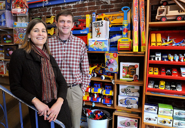 Marblehead:<br /> Kristen Pollard and her husband Sam Pollard stand in their store, Mud Puddle Toys. The Pollards are going to open a second Mud Puddle Toys in Salem<br /> Photo by Ken Yuszkus/Salem News, Wednesday, February 4, 2010.
