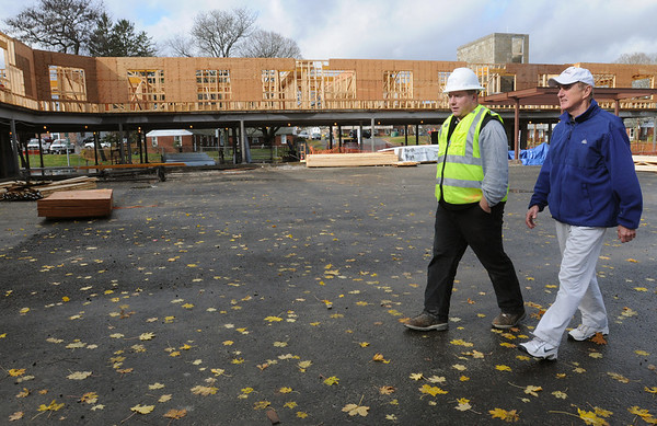 Ipswich:<br /> Brian Senk, left, superintendent at the construction site, and Gerry Beauchamp, YMCA director, tour the affordable housing project under construction. It will be called Powder House Village.<br /> Photo by Ken Yuszkus/Salem News,  Wednesday,  November 17, 2010.