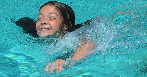 Salem:<br /> Caitlynn Burke, 9, of Salem, swims in the Forest River Pool on opening day. It's a good way to cool off since hot weather is expected the next few days.<br /> Photo by Ken Yuszkus/Salem News, Friday, June 29,  2012.