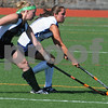 Wenham:<br /> Left, Morrisville State College's Katie Pingrey and Gordon College's Melinda Fowler reach for the ball during the field hockey game at Gordon College.<br /> Photo by Ken Yuszkus/Salem News, Tuesday, September 1, 2009.