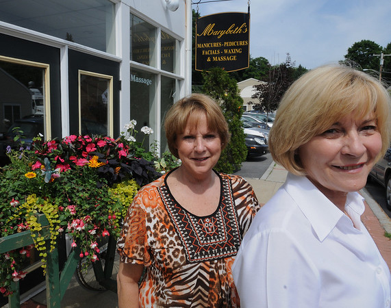 Hamilton:<br /> Brenda Morrison, left, and June Singer, co-owners of Marybeth's, stand outside their business. Marybeth's at 58 Railroad Street is one of the winners of Hamilton's first Downtown Beautification Competition.<br /> Photo by Ken Yuszkus/Salem News, Wednesday, June 16, 2010.
