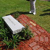 Ipswich:<br /> Judy Buttery looks at one of the bricks which has her mother's name, Arline Comeau. The bricks with various names and the granite bench make up the memorial in front of the Doyon Elementary School which was just dedicated Thursday afternoon.<br /> Photo by Ken Yuszkus/Salem News, Thursday, May 10, 2012.
