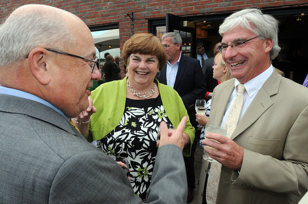 Danvers:<br /> From left, Nelson Benton, his wife Laurie, and Ira Singer, Middleton town administrator, talk at Nelson Benton's retirement party which was held at the Danvers Yatch Club.<br /> Photo by Ken Yuszkus/Salem News, Wednesday, June 27,  2012.